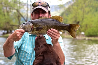 "Chris L. and Cooper with a quick 20"" smallie"