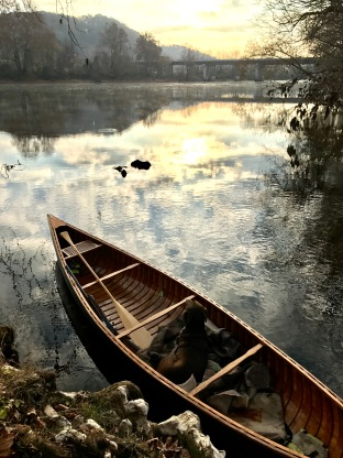 Wooden Canoe and Duck Water